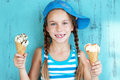 Child with ice cream portrait of years old kid girl eating tasty over blue Royalty Free Stock Image