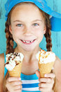 Child with ice cream portrait of years old kid girl eating tasty over blue Royalty Free Stock Photo