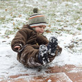 Child on icy slippery road toddler falling pavement or sidewalk in winter Stock Photos