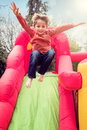 Child on inflatable bouncy castle slide Royalty Free Stock Photo