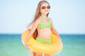 Child with inflatable ring sunglasses and at the beach Royalty Free Stock Photos