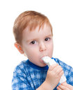 Child with inhaler does medicine procedure Royalty Free Stock Photos