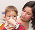 Child and inhaler european boy treated with a nebulizer Stock Photo