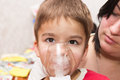 Child and inhaler european boy treated with a nebulizer Royalty Free Stock Images