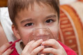 Child and inhaler european boy treated with a nebulizer Royalty Free Stock Photo