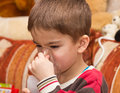 Child and inhaler european boy treated with a nebulizer Stock Images