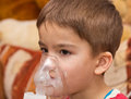 Child and inhaler european boy treated with a nebulizer Royalty Free Stock Photos