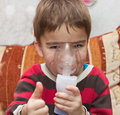 Child and inhaler european boy treated with a nebulizer Royalty Free Stock Image