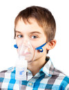 Child with inhaler mask portrait of cute boy using nebulizer on white background Stock Photography