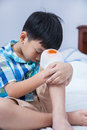 Child injured wound on the child s knee with bandage bed in bedroom bloody sad boy human health care and medicine concept Stock Images
