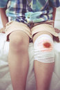 Child injured. Wound on the child's knee with bandage. Vintage s Royalty Free Stock Photo