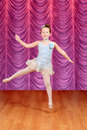 Child jumping ballerina dancer on stage Royalty Free Stock Photo