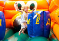 Child jumping on bouncy castle Royalty Free Stock Image