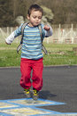 Child jumping hopscotch Royalty Free Stock Photo