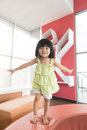 Child jumping on sofa little asian girl happily Royalty Free Stock Photography