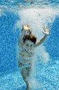 Child jumps to swimming pool Royalty Free Stock Image