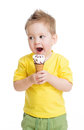Child or kid eating ice cream isolated Stock Photos