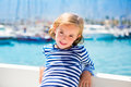 Child kid girl in marina boat on summer vacations Royalty Free Stock Photo
