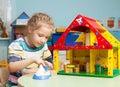 Child in kindergarten kids nursery school girl playing at infant school game Royalty Free Stock Photo