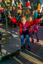 Child on kirtag in kettenkarusell carousel ka rides a fairground with a chain and having fun Royalty Free Stock Image