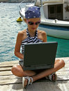 Child with laptop in harbor Stock Photos