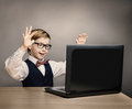 Child with laptop little boy in glasses amazed looking computer happy at school kid raised hands over gray background internet Stock Photos