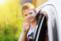 Child leaned out the window of a car Royalty Free Stock Photo