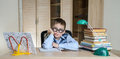 Child with learning difficulties. Tired boy doing homework. Education. Royalty Free Stock Photo