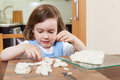 The child learns to mold dough figurines
