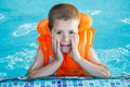 Child in life jacket posing swimming pool Royalty Free Stock Photography