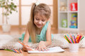 Child little girl child kid drawing at home Royalty Free Stock Photo