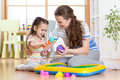 Child little girl and mother playing with kinetic sand at home Royalty Free Stock Photo