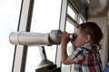 Child looking through pay binoculars Royalty Free Stock Photo