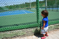 Child looking tennis court Royalty Free Stock Photography