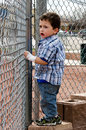 Child looking thru fence Royalty Free Stock Photo