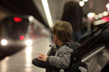 Child looking at train arriving in the subway station Royalty Free Stock Images