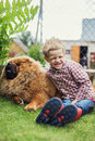 Child lovingly embraces his pet dog. Chow Chow Royalty Free Stock Photo