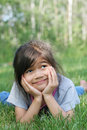 Child lying on grass smiling Royalty Free Stock Image