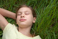 Child lying on a green meadow in nature Royalty Free Stock Photography
