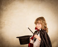 Child magician holding top hat and magic wand success concept Stock Photos