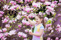 Child with magnolia flower. Little girl with flowers Royalty Free Stock Photo
