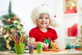 Child making christmas tree of plasticine Royalty Free Stock Photo