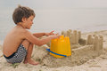Child making sand castles at the beach Royalty Free Stock Photo