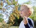 Child making soap bubbles outside Royalty Free Stock Photo