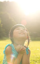 Child is making wish Royalty Free Stock Photo