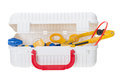 Child medical kit to play doctor open full of supplies toys in primary colors red blue and yellow isolated Stock Images