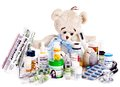 Child medicine and teddy bear isolated Royalty Free Stock Images