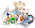 Child medicine and teddy bear isolated Royalty Free Stock Photos