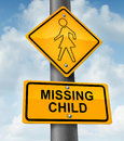 Child missing concept with a yellow school crossing traffic warning sign with a dotted figure of a little girl as a symbol of Royalty Free Stock Images