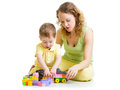 Child and mom play with block toys boy Stock Photos